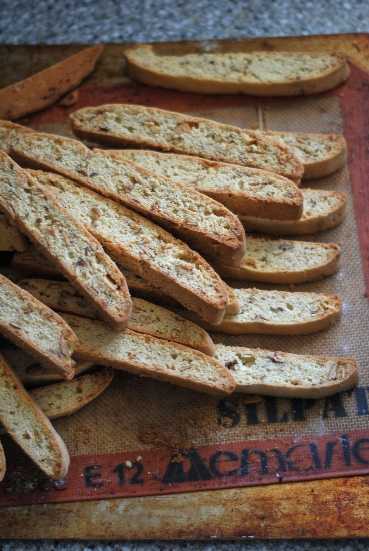 Classic Almond Biscotti. 3 1/4 cups all purpose flour, 1 tbsp baking powder, 1/4 tsp salt, 1 1/2 cups sugar, 10 tbsp (1 1/4 sticks) unsalted butter, melted, 3 eggs, 1 tbsp vanilla extract, 1 tbsp almond extract, 1 cup almond slices, toasted