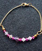 PULSERA PRECIOSA Y MURANO ROSA: Pulsera en preciosa rosa y murano lila, herrajes dorados.