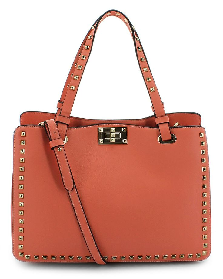 Olivia and Joy handbag orange. Lots of storage. No rips or tears. Small spot on bottom. Shown in pictures. Awesome color for spring or summer.
