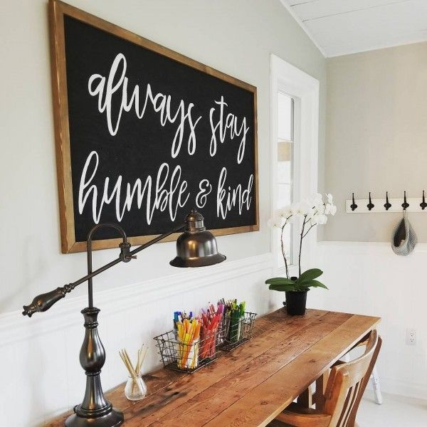 Check out this #farmhouse style home office decor with a rustic wood plank tabletop and sign wall art. Love it! #HomeDecorIdeas #HomeOfficeIdeas #FarmhouseStyle @istandarddesign
