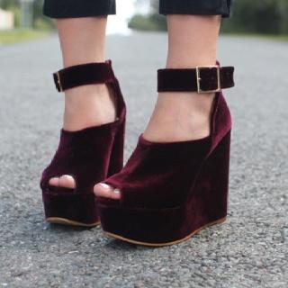 Nothing more festive than burgundy velvet. Even on platform sandals.