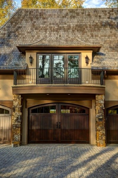 Love the roof line, arched garage doors, balcony for guest room above garage.