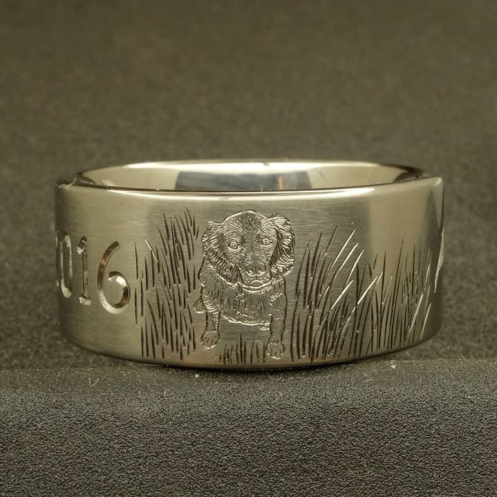Dogs and duck seem to go together like PB&J. This time it is a Boykin spaniel with a committed pair of locked up ducks on a 10mm titanium ring. Your ideas become your ring. What do you see your ring looking like? #FashionJewelry #SterlingSilver #Rings #Bracelets #Earrings #SilverCharms #Brooches #NoseRings #BarBellsEarrings #Engagement Rings #Wedding Rings #Promise Rings #wedding 2016 #Wedding Rings