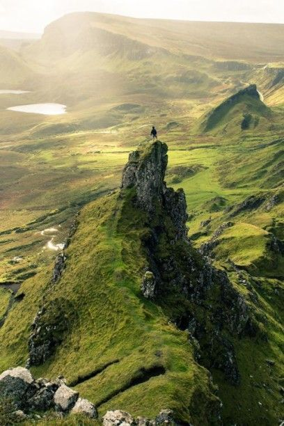 The Quiraing in Skye, Scotland. Beautiful tourist destination for sightseeing when traveling and going on road trips. Great landscape to take beautiful photography and when planning on things to do in Scotland.