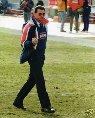 Chicago Bears coach Mike Ditka shooting birds to the crowd.