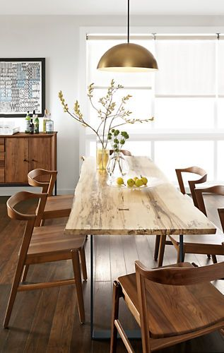 Each Chilton table features a shape and grain as unique as the tree it came from. A solid slab of wood is sanded and finished, braced with walnut butterfly joints in any areas requiring extra support, and secured to a hand-welded natural steel base.