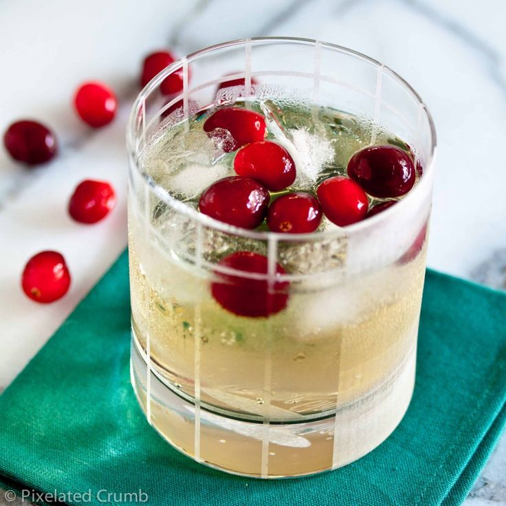 cranberry ginger cocktail....5 oz vodka  4 oz ginger beer (Reed's Original Ginger Brew), handful of fresh cranberries...  Combine vodka and ginger in a glass with ice. Place cranberries in a small bowl and use a muddler (or a spoon or fork) to smash them up a bit. Pour cranberries and any juice you squeezed out on top the cocktail, stir.