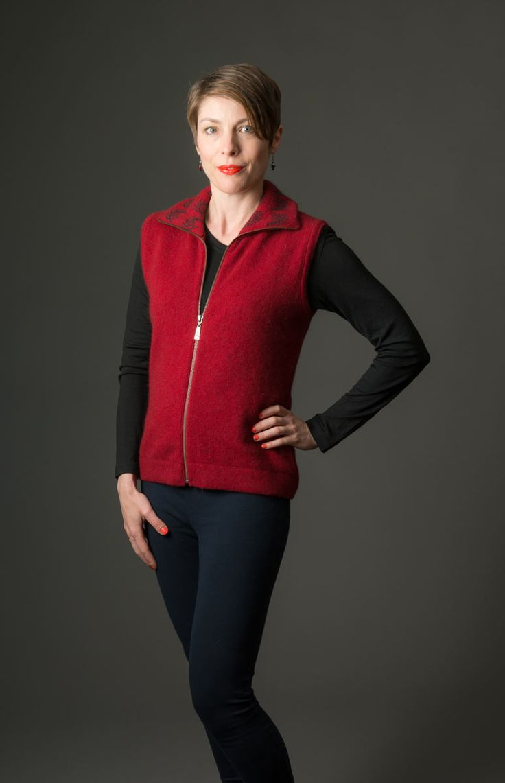 This red women's possum merino vest has a front zip and a fern design on the collar. It is easy wearing for the weekend or smart casual for during the day at work. Dress this merino vest up with jewellery. Available online at Gorgeous Creatures.