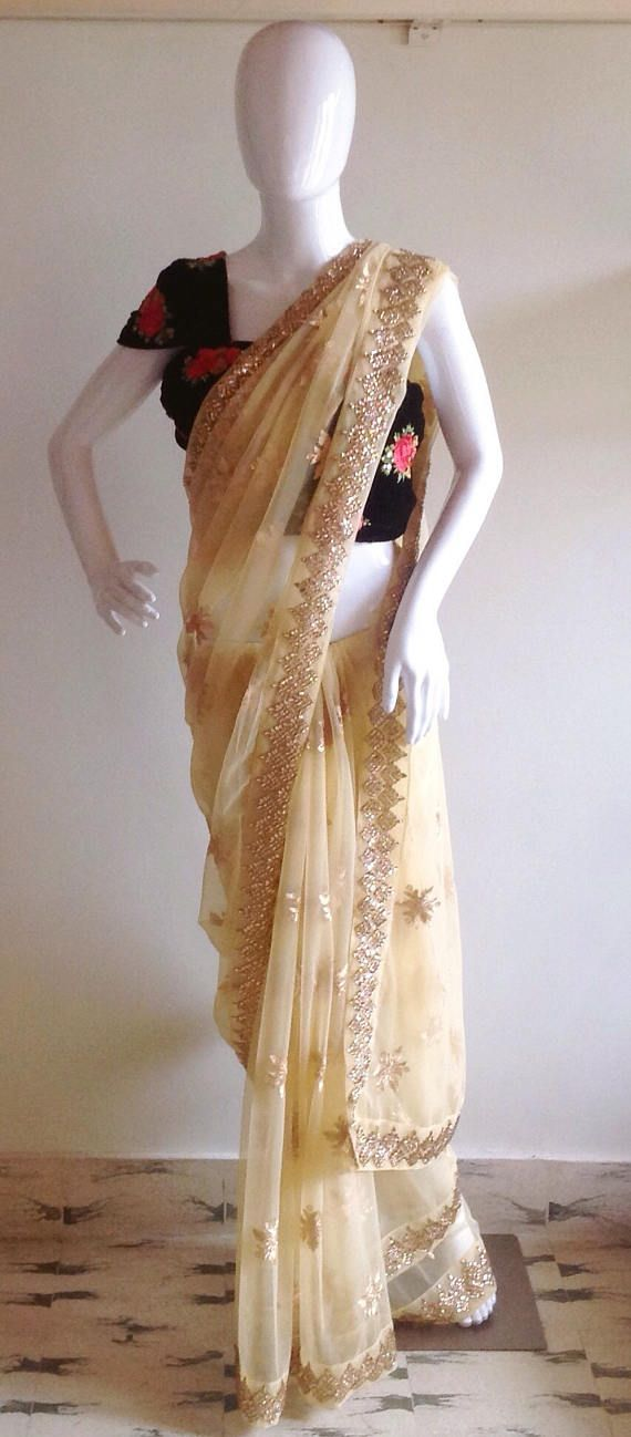 759de7cfd3ffa Gold net saree with a black velvet blouse with floral and sequin  embroidery. Saree fabric