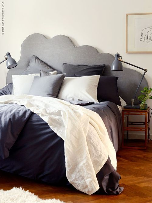 Sleeping on a raincloud. Cloud headboard, fluffy grayscale scheme