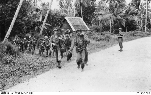 Terendak, Malaya. 1964-10-29. Captured Indonesian infiltrators emerge from the jungle, south of Terendak, under the guard of soldiers from 'D' Company, 3rd Battalion, The Royal Australian Regiment (3RAR).