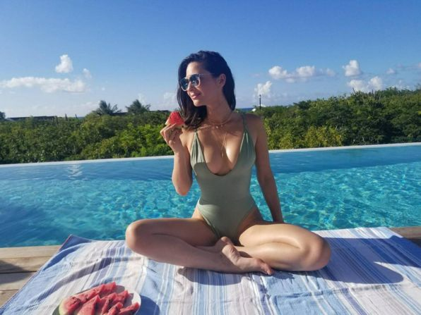 Olivia Munn wearing the Gooseberry Seaside So Chic One Piece in Oasis