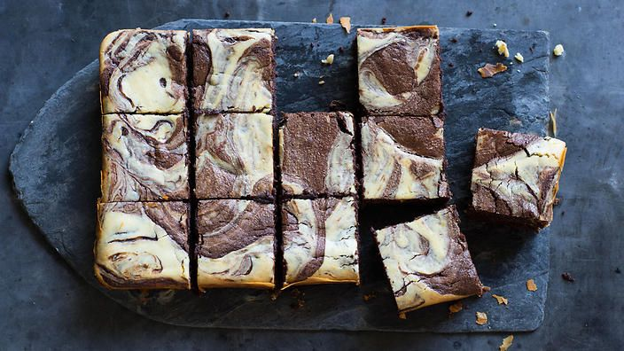 """These fudgy """"black and white"""" brownies are marbled with an orange-scented cheesecake. Perfect with a cuppa or after dinner pick-me-up. Recipe from  Anneka Manning. Check out our Bakeproof column for tips and recipes."""