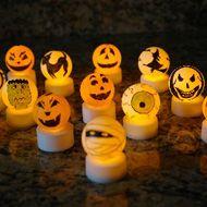 Light Up Hallowen Crafts*****Ping Pong balls and battery powered tea lights.