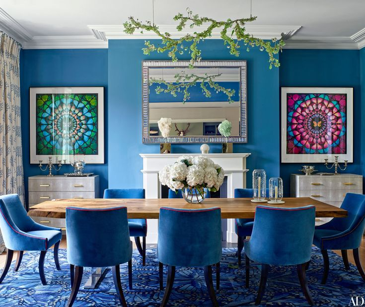 A Blue Dining Room Displaying Two Damien Hirst Butterfly Artworks