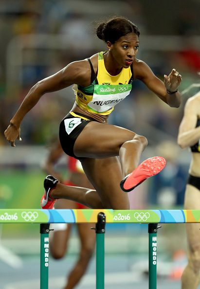 Leah Nugent of Jamaica competes in the Women's 400m Hurdles Semifinals on Day 11…