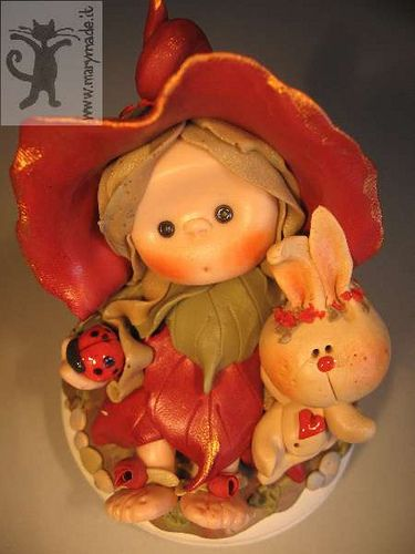 https://flic.kr/p/4AKUeE | red leaf girl with pet bunny | Hand-made doll with her pet bunny rabbit and good-luck charm.... lady bug! Visit my website.
