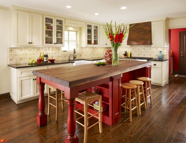 Love the big island and that color, looks great with the white cabinets and the natural wood!