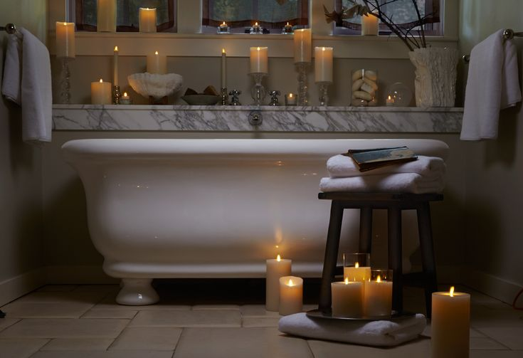 Luminara candles around the bathtub