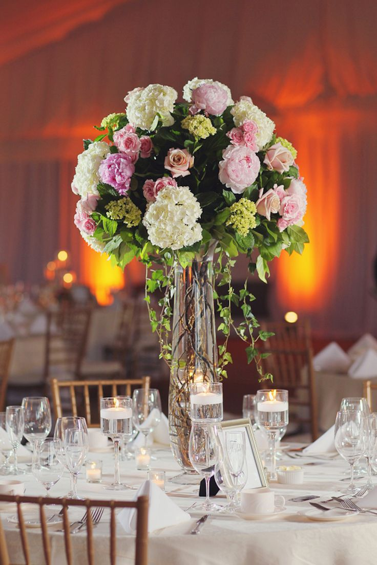Guest tables featured tall vases filled with branches, overflowing with ivy, and topped with peonies, hydrangeas, and roses in shades of pink and ivory. #centerpiece Photography: Vanessa Joy Photography. Read More: http://www.insideweddings.com/weddings/a-garden-inspired-summer-wedding-at-a-golf-club-in-new-jersey/631/