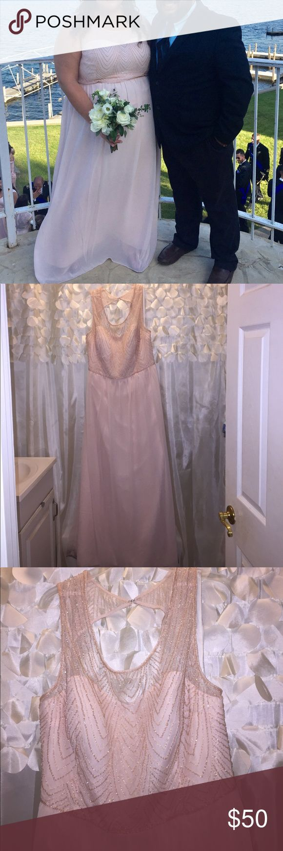 Gorgeous Blush Bridesmaids Dress Loved this dress that I wore in my best friend's wedding! It's a size 22 but honestly I'm generally an 18 so I think it rubs small. It has a pull on the front heading that I noticed the am of the wedding and it was fine, didn't show in pics. I also found a little pull in the back. This has not been altered and was just a bit long on me...I'm 5'6 and wore flats. This dress has not been cleaned. Make me an offer I can't refuse, this beauty needs a new home…