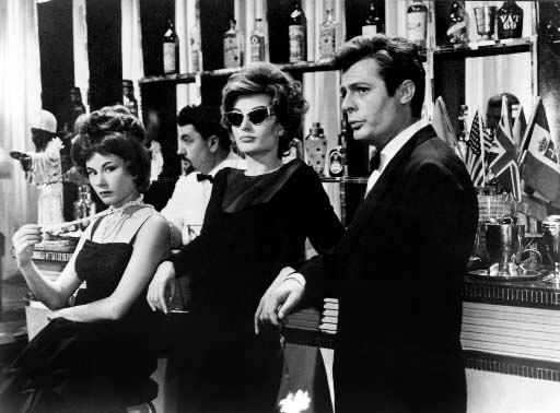 La Dolce Vita, de F. Fellini. Anouk Aimée, Marcello Mastroianni. Federico Fellini (Italian pronunciation: [fedeˈriːko felˈliːni]; January 20, 1920 – October 31, 1993) was an Italian film director and scriptwriter. Known for a distinct style that blends fantasy and baroque images, he is considered one of the most influential filmmakers of the 20th century, and is widely revered.[1] He won five Academy Awards and was nominated for 12 in a career that spanned over forty years.