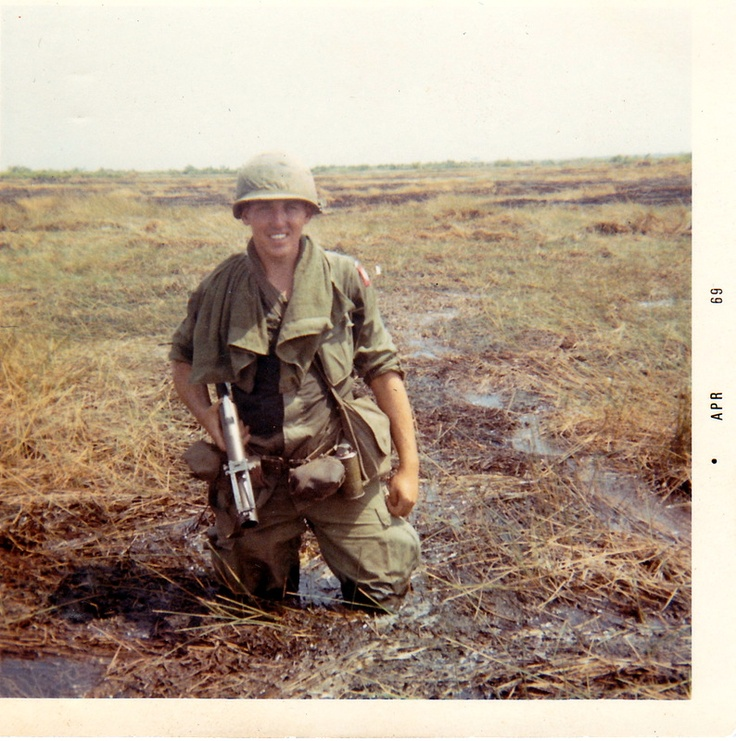 Ron Wolford in 1968 with his trusty M-79 Grenade Launcher in a swamp in South Vietnam. ~ Vietnam War