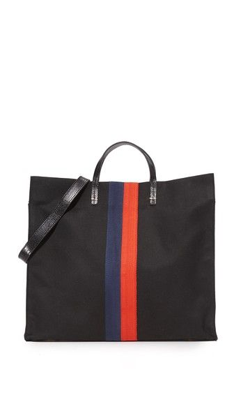 A roomy canvas Clare V. tote accented with colorful printed stripes. Metal feet add stability. A magnetic snap closes over a lined, 1-pocket interior. Top handles and optional shoulder strap.