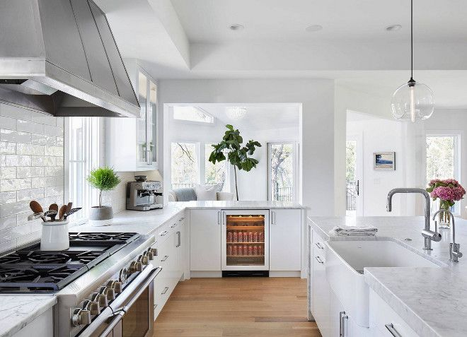 "Kitchen perimeter and island countertop. Kitchen Countertop: Honed Bianco Gioia Extra Marble. Kitchen Backsplash: Walker Zanger Café-Milk 3"" x 12"" Tile in Brick Pattern. #Kitchen #countertop #backsplash Martha O'Hara Interiors"