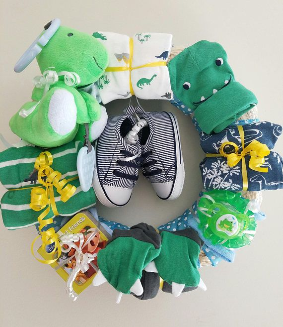 This wreath has a fun dinosaur theme to it and comes ready to gift or display! Brand new, brand name baby items are beautifully arranged on this wreath for an awesome presentation, but baby can also use them later! Display it at the baby shower, in babys nursery, or at the hospital for