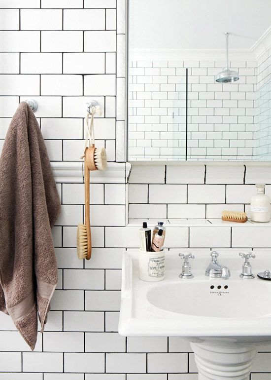 White bathroom tiles with dark joints ©Sean Fennessy