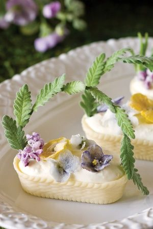 Chocolate baskets filled with whipped cream and lemon zest and decorated with chocolate flowers