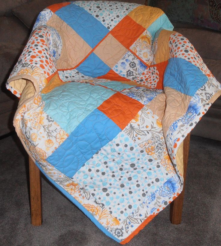 Dissapearing Nine Patch Lap Quilt in bright's. Sold