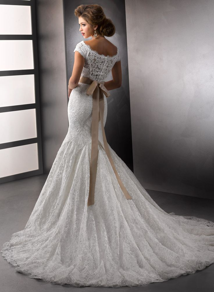 I am absolutely in love with this dress. I can't stop looking at it. Amara Rose - by Maggie Sottero