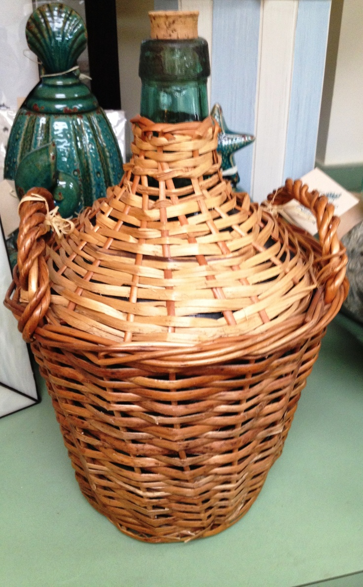 A wicker jug is a great look for an outdoor seating arrangement on a buffet, or in a glass cabinet in your kitchen.