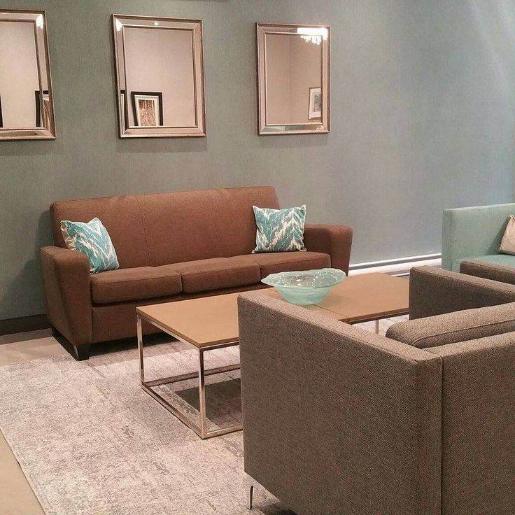 Apartment lobby.  Neutral clean lines with a pop of colour.  #commercialdesign #lobby #grey/brown/turquoise #accentpieces