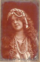 Vintage German Biogravure real photo glamour postcard of a young woman in pearls.
