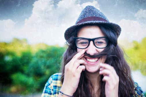 Stock Photo : Hipster Girl Using Her Hair as a Mustache