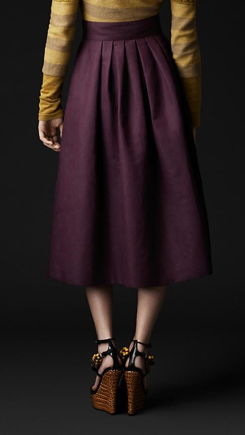 Still love the classic tailored look of the mid length skirt, especially in the plum purple with a chartreuse top!
