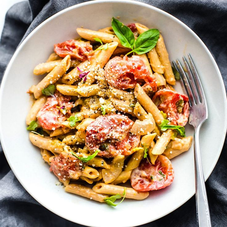 A Gluten Free Penne Pasta dish that's quick to make, creamy, and dairy free . This tomato Gluten Free Penne Pasta recipe is a light healthy pasta dish.