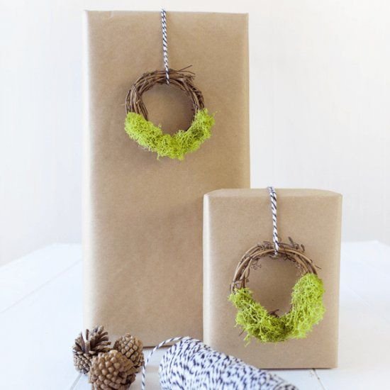 Take your gift wrap to the next level with these super easy to make Mini Moss Wreath Gift Toppers!: