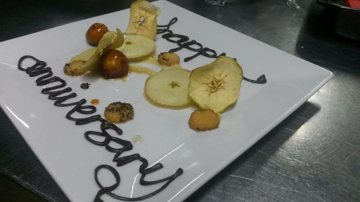 Apple done 5 ways on an anniversary plate. Toffee apples, apple crisps, white wine, honey and apple jelly, apple poached in vanilla and mint syrup and salted caramel apple puree.   Image courtesy of Sam Cooper - Head Chef at Victoria Falls River Lodge