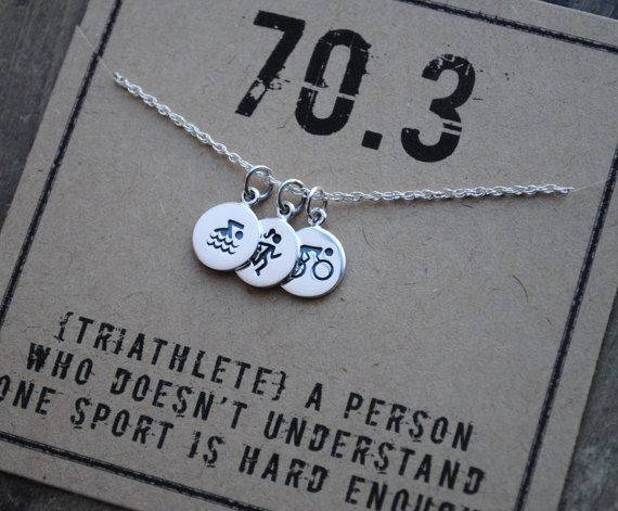 { TRIATHLETE 70.3 Necklace . Definition of a Triathlete . Swim Bike Run Triathlon . Iron Man Race}   for the triathlete . for the perfect pre - race gift . to celebrate the completed Triathlon  {three} tiny sterling pendants {just under 1/2 each in diameter} : {included are: swim, bike, run images} . {card reads} 70.3 {Triathlete} A person who doesnt understand one sport is hard enough . {one} delicate sterling chain of choice  {all necklaces come packaged and ready to gift}  thx and God...