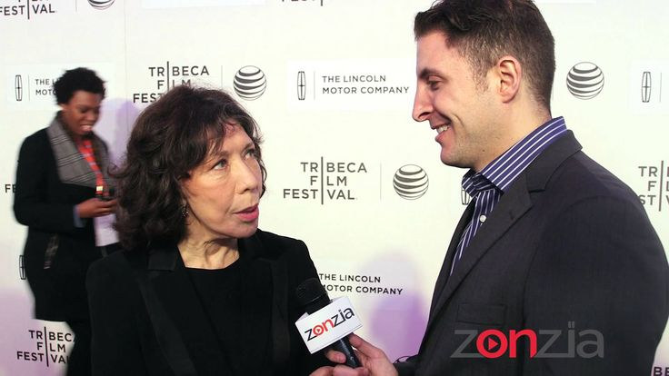 """Paul Weitz' """"Grandma"""" is about an aging poet (played by Lily Tomlin) mourning the death of her partner. After her teenage granddaughter unexpectedly shows up, the unlikely duo embark on a road trip revealing hidden secrets along the way. Arthur Kade chats with Lily Tomlin, Laverne Cox, Nat Wolff, Julia Garner and writer/director Paul Weitz."""