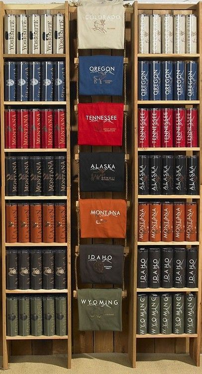 This is an interesting way to display tshirts.  I like how they've made a rope ladder to drape each shirt off of, right alongside the shelf containing the tshirts.