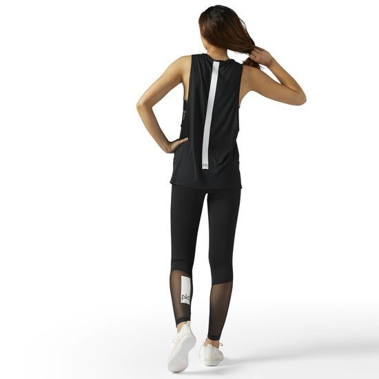 Reebok - LES MILLS Musle Tank: Work out in comfort and ease in the LES MILLS Muscle Tank. Designed to move with you, this tank allows for function and comfort. Dropped armholes add to the breathability and freedom of motion durign any studio classes.