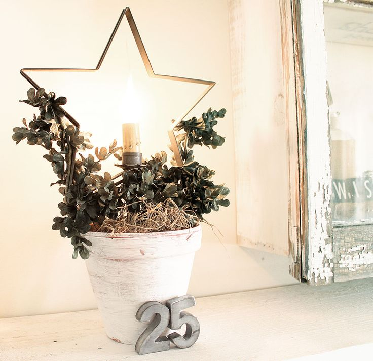 Inspired idea... paint an old (or chap) pail or planter, fill with foam, cover with moss & add a few pretty vines, twigs, berries and/or a small bloom or two.  Insert a decorative tin shape (a star is perfect for Xmas) and add an electric candle in the center).