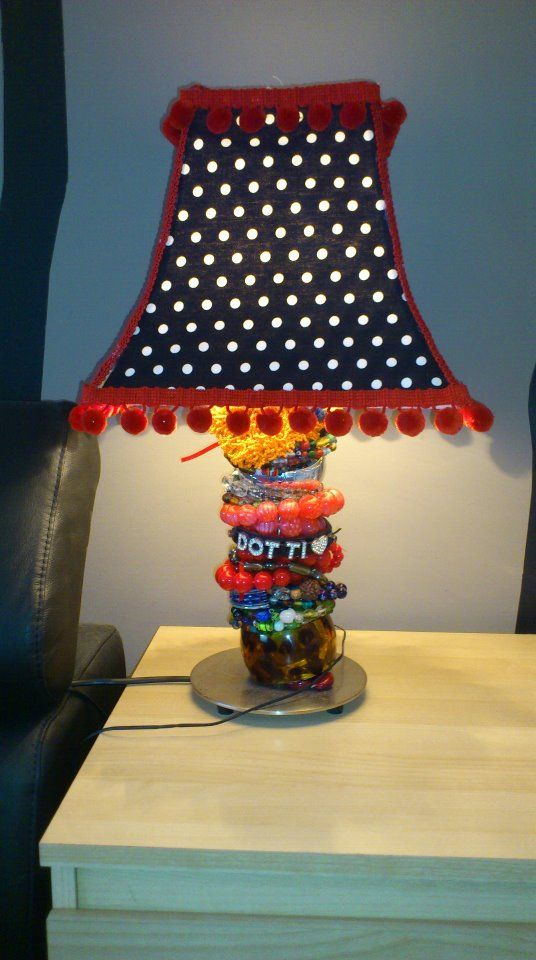 a lamp that Moo made for Davo - old bangles and necklaces were used to build up the thickness of the base, a good upcycle