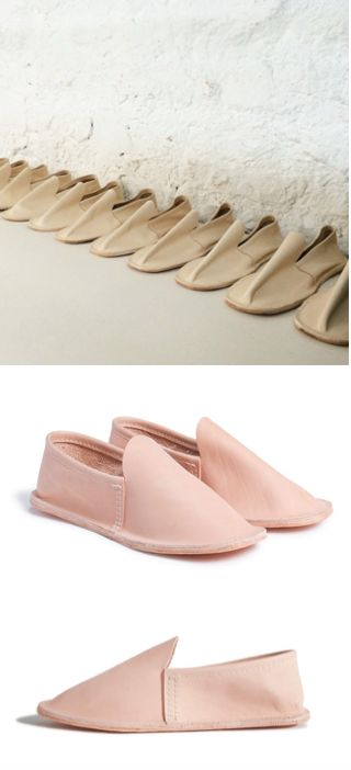 Hand-cut, vegetable-tanned leather slippers with wool felt insole and leather outsole. Now available in natural, vegetable tan leather.