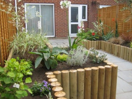 Image result for wood poles flower beds